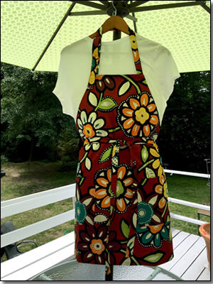 Chef's Apron with Bold Colorful Flowers on Dark Red Background