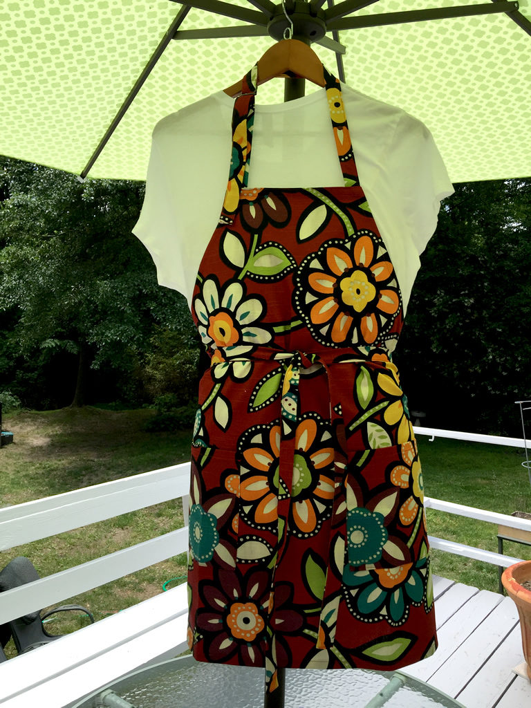 Chef's apron featuring bold colorful flowers.