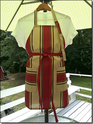 Chef's apron featuring large stripes in brick red and sand beige.  (APR-002)