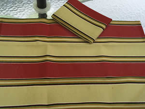 Decorative towel featuring large stripes in brick red and sand beige.  (TWL-002)