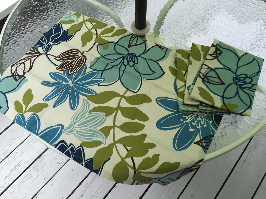 Decorative towel featuring blue flowers and green leaves. (TWL-012)