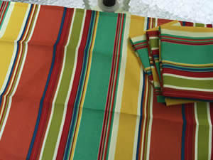 Decorative towel featuring stripes in orange, teal green and yellow. (TWL-005)