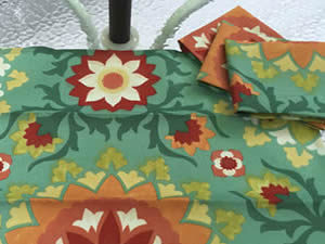 Decorative towel featuring bold flowers on a teal green background (TWL-006)