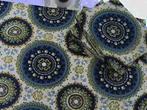 Decorative towel featuring blue and green deco circles. (TWL-009)