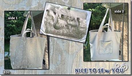 Reversible tote bag featuring gray tapestry and herringbone pattern fabrics.